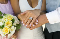 Brides hands and wedding ring  close-up