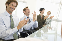 Business colleagues applauding in business meeting