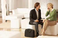 Business couple in living room