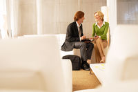 Business couple talking in living room