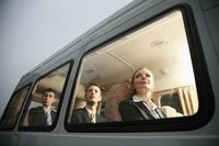 Business people in a van looking out through the window