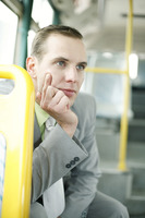 Popular : Businessman daydreaming in the train