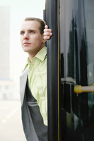 Popular : Businessman getting down from a bus