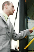 Businessman getting on bus