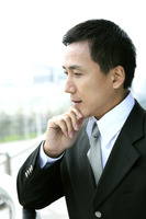Popular : Businessman holding his chin