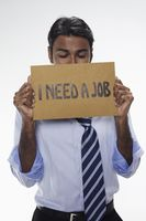 Businessman holding  i need a job  sign