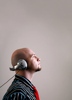 Popular : Businessman listening to music on the headphones