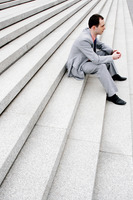 Popular : Businessman sitting on the staircase