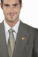 Businessman with gold star on suit portrait