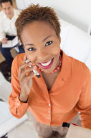 Businesswoman on cell phone indoors portrait high angle view