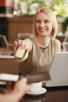 Businesswoman paying with credit card