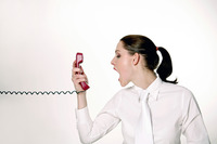 Businesswoman screaming into the phone