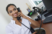 Businesswoman using telephone