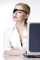Businesswoman with eye patch using laptop