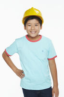 Cheerful boy with a construction helmet