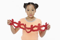 Cheerful girl with a human paper chain