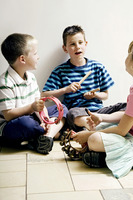 Children playing with musical instrument