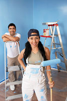 Couple in freshly painted room portrait elevated view