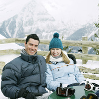 Couple in warm clothing smiling at the camera