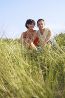 Couple relaxing on dunes
