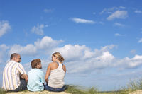 Family sitting on dunes