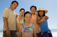 Family with girl  7-9  on beach  portrait