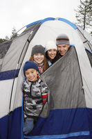 Family with two children  7-12  in tent  portrait