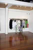 Female clothes hanging on rack in fashion boutique