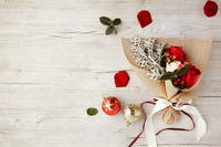Flat of wooden background with bouquet of roses