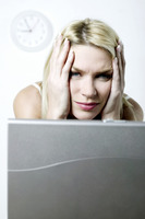 Popular : Frustrated woman using laptop