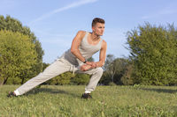 Popular : Full length of confident man exercising in park