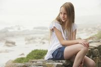Girl sitting on wall
