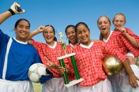Popular : Girls  soccer team  13-17  holding trophy and celebrating portrait