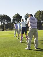 Popular : Golfers teeing off back view