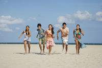 Popular : Group of teenagers  16-17  running on beach