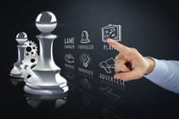 Hand pointing towards chess piece and infographic elements