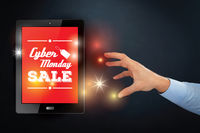 Hand reaching out towards tablet with cyber monday concept