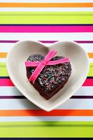 Heart-shaped chocolate fudge cake with pink ribbon