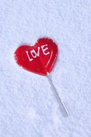 Heart-shaped lollipop in snow