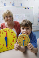 Little boy learning to tell time