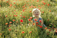 Little girl smiling in a field of flowers