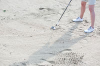 Popular : Low section of woman playing at golf course
