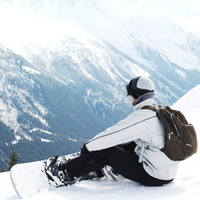 Male snowboarder with backpack