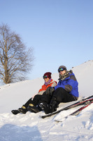 Man and woman relaxing after skiing