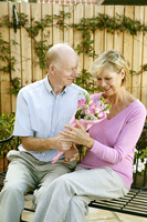 Popular : Man giving his wife a bouquet of flowers