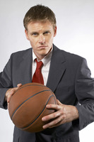 Popular : Man in business suit holding a basketball