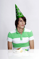 Popular : Man in party hat with cake on the table