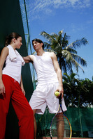 Man talking to woman in the tennis court