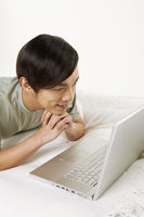Popular : Man using laptop on the bed