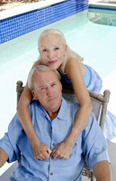 Old couple posing by the pool side